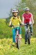 Bike riding - young girl with mother on bike