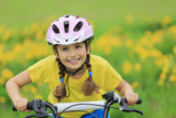 Bike riding - young girl on bike, active child concept