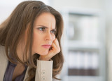 Portrait of frustrated business woman sitting in office