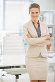 Portrait of smiling business woman standing in office