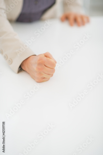 Closeup on business woman knocking on table with fist