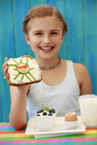 Summer breakfast - cute girl eating healthy breakfast