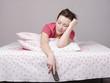 Молодая девушка уснула с пультом в постели
