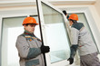 two workers installing window - 62140955