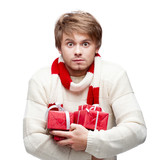 young funny man holding christmas gifts