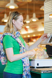 Young woman at food shopping in supermarket
