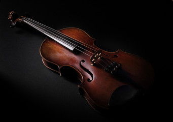 Vintage violin on dark background