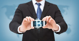 businessman with smartphone and bitcoin on screen