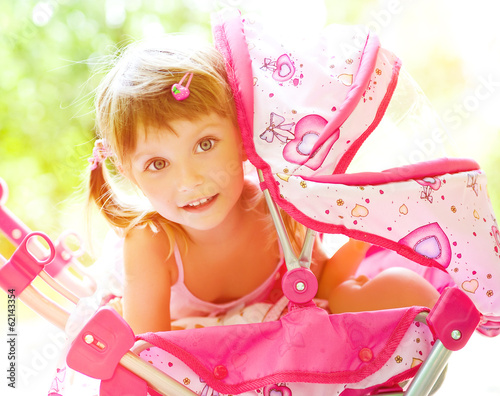 Child with toy carriage