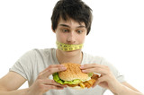 Man with a centimeter on his mouth unable to eat a big hamburger