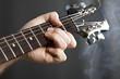 Close up on man playing guitar