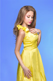 Trendy young woman in funky yellow dress