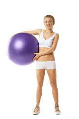 Young  woman with fit-ball isolated over white