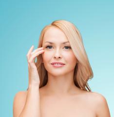 beautiful woman touching her eye area