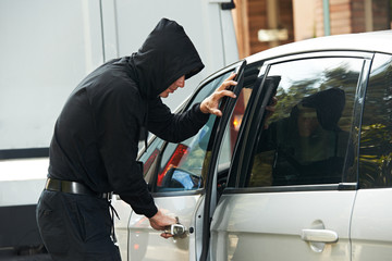 thief burglar at automobile car stealing
