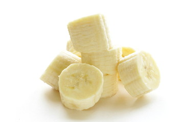 fresh ripe banana cut into pieces on white background