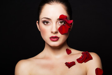 Fashion portrait of woman with rose petals