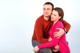 Husband hugs his pregnant wife, happy pregnancy.