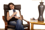 older woman sleep with book in chair