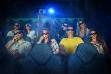 People in 3D Cinema with grim reaper