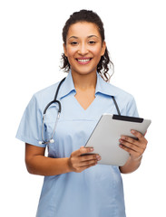 doctor or nurse with stethoscope and tablet pc