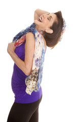 woman purple tank top scarf head back laugh