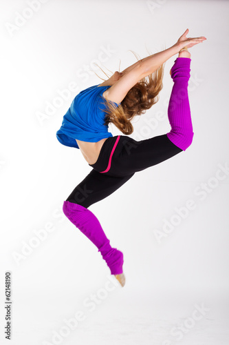 young beautiful dancer teen girl dancing and jumping