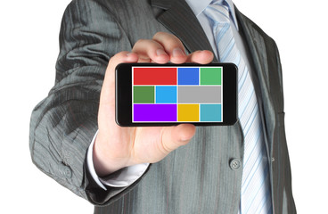 Man shows smart phone with color flat icons on white background.