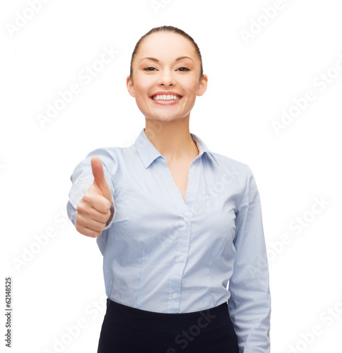 young smiling businesswoman showing thumbs up