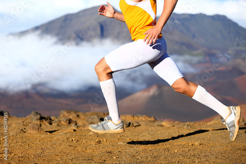 Trail running - male runner in cross country run