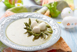 Spring green broccoli soup with asparagus nest