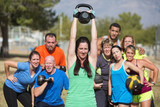 Smilng Lady Lifting Kettle Bell