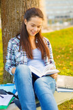 smiling teenager reading book