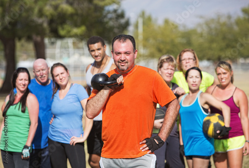 Man Holding Kettle Bell Weight