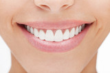 Closeup of smile with white healthy teeth - 62150145