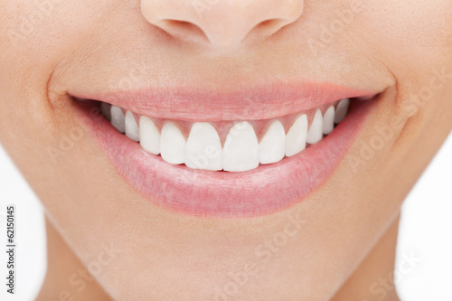 Fototapeta Closeup of smile with white healthy teeth