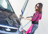 Young Woman Washing Car