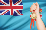 Medal in hand with flag on background - Republic of Fiji