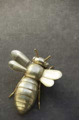 Metallic Bee on wall