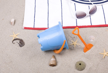 beach items on a towel and sand