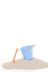 A blue Bucket and  shovel on the beach