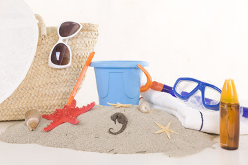 beach bag with toys and sunglasses for the whole family