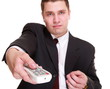 man with remote control changing channel