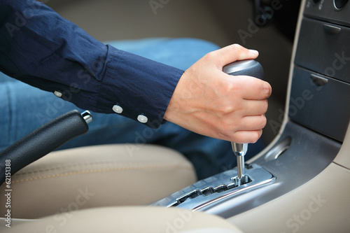 hand shifting the gear stick