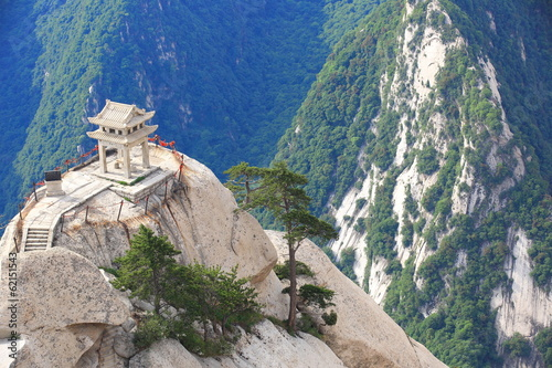 stone pagoda buit on the stone cliff at mountain huashan