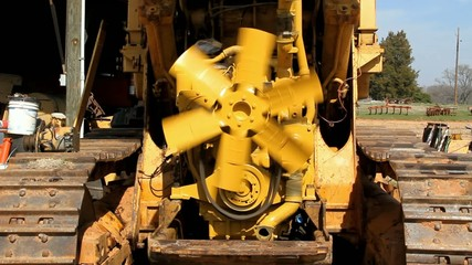 Spinning Fan Blade With Stuff In A Barn And Plows