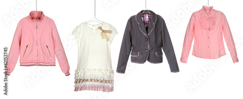 fashion girl's clothes on hangers isolated on white background