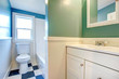 White bathroom with green and blue walls