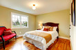Cozy warm colors bedroom with french window