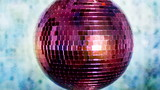 funky pink mirror ball spinning with patterns of light